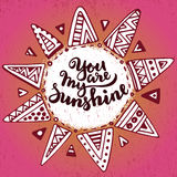 Handwritten quote You are my sunshine on ethnic ornate sun background Royalty Free Stock Photos