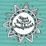 Handwritten quote You are my sunshine on ethnic ornate sun background Royalty Free Stock Images
