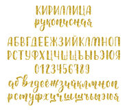 Handwritten russian cyrillic calligraphy brush script with numbers and symbols. Gold glitter alphabet. Vector Stock Photo