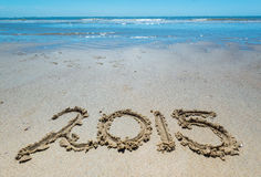 2015 handwritten in the sand of the beach. Text in the sand on the beach during the summer holidays Royalty Free Stock Photography