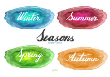 Handwritten season names on watercolor background. Handwritten names of seasons: spring, summer, autumn, winter on abstract watercolor textures isolated on white Royalty Free Stock Photography