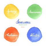 Handwritten season names on watercolor background. Handwritten names of seasons: spring, summer, autumn, winter on abstract watercolor textures isolated on white Royalty Free Stock Photos