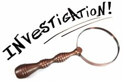 Handwritten Sign INVESTIGATION and Retro Magnifying Glass royalty free stock image