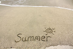 Handwritten summer on sand. It was taken in a beach of Hong Kong, shows the feel of summer Stock Photography
