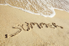 Handwritten summer on sand Stock Image
