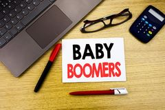 Handwritten text caption showing Baby Boomers. Business concept writing for Demographic Generation written on paper, wooden backgr royalty free stock photo