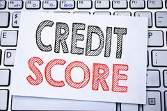 Handwritten text caption showing Credit Score. Business concept writing for Financial Rating Record written on sticky note paper o. N white keyboard background royalty free stock photo