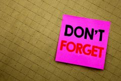 Handwritten text caption showing Do Not Forget. Business concept writing for Don t memory Remider written on sticky note paper on. Yellow background Stock Images