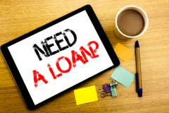 Handwritten text caption showing Need A Loan Question. Business concept writing for Mortage Credit Written on tablet laptop, woode. Handwritten text caption Stock Images