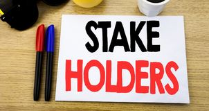 Handwritten text caption showing Stake Holders. Business concept writing for Stakeholder Engagement written on sticky note with co. Py space old wood wooden stock images