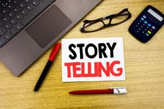 Handwritten text caption showing Storytelling. Business concept writing for Teller Story Message written on paper, wooden backgrou. Nd in office copy space Royalty Free Stock Photography