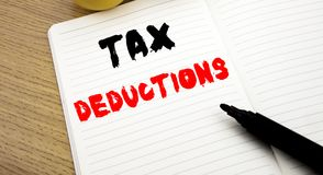 Handwritten text caption showing Tax Deductions. Business concept writing for Finance Incoming Tax Money Deduction written on note. Handwritten text caption Royalty Free Stock Photo