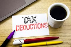 Handwritten text caption showing Tax Deductions. Business concept writing for Finance Incoming Tax Money Deduction written on note. Book book on wooden Royalty Free Stock Photos