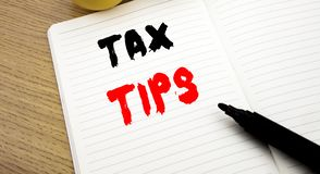Handwritten text caption showing Tax Tips. Business concept writing for Taxpayer Assistance Refund Reimbursement written on notebo. Handwritten text caption stock images