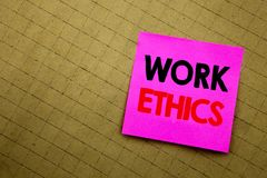 Handwritten text caption showing Work Ethics. Business concept writing for Moral Benefit Principles written on sticky note paper o. N yellow background Stock Photography