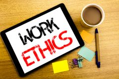 Handwritten text caption showing Work Ethics. Business concept writing for Moral Benefit Principles Written on tablet laptop, wood. Handwritten text caption Royalty Free Stock Photography