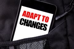 Handwritten text showing Adapt To Changes. Business concept writing for Adaptation New Future Written phone mobile phone, cellphon. E placed in  man front jeans Royalty Free Stock Images