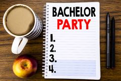Free Handwritten Text Showing Bachelor Party. Business Concept For Stag Fun Celebrate Written On Notepad Note Paper On The Wood Structu Royalty Free Stock Photography - 111001557