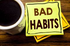 Handwritten text showing Bad Habits. Business concept for Improvement Break Habitual Hebit written on sticky note paper on the woo. Handwritten text showing Bad Royalty Free Stock Images