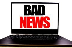 Handwritten text showing Bad News. Business concept writing for Failure Media Newspaper Written on monitor front screen, white bac. Kground with space view Stock Photo