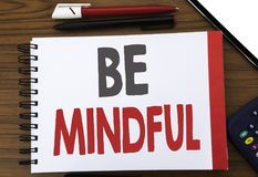 Handwritten text showing Be Mindful. Business concept writing for Mindfulness Healthy Spirit Written on notepad note paper, wooden. Handwritten text showing Be Stock Photo