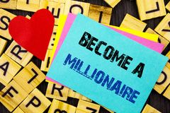 Handwritten text showing Become A Millionaire. Conceptual photo Ambition To Become Wealthy Earn Fortune Fortunate written on color. Handwritten text showing Stock Images