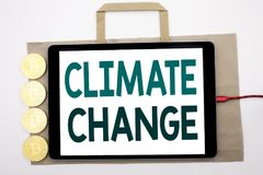 Handwritten text showing Climate Change. Business concept writing for Global Planet Warming Written on shopping bag and tablet wit. Handwritten text showing royalty free stock image