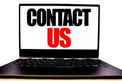 Handwritten text showing Contact Us. Business concept writing for Customer Support Written on monitor front screen, white backgrou. Nd with space view stock images