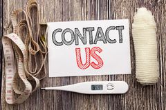 Handwritten text showing Contact Us. Business fitness health concept writing for Customer Support written sticky note empty paper. Handwritten text showing stock images