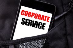 Handwritten text showing Corporate Service. Business concept writing for Csr Digital Content Written phone mobile phone, cellphone. Placed in  man front jeans Royalty Free Stock Images