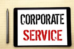 Handwritten text showing Corporate Service. Business concept writing for Csr Digital Content Written on tablet computer screen, wh. Ite background office space Royalty Free Stock Photo
