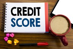 Handwritten text showing Credit Score. Business concept writing Financial Rating Record Written on notepad note paper, old black w. Handwritten text showing stock images