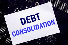 Handwritten text showing Debt Consolidation. Business concept for Money Loan Credit Written on sticky note, computer main board ba. Handwritten text showing Debt Royalty Free Stock Photography