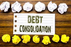 Handwritten text showing Debt Consolidation. Business concept for Money Loan Credit Written on sticky note, wooden with sticky, ma. Handwritten text showing Debt Royalty Free Stock Images