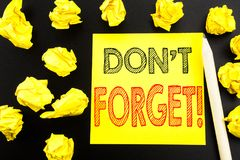 Handwritten text showing Do Not Forget. Business concept writing for Reminder Message written on sticky note paper on the black ba Stock Image