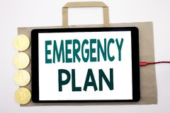 Handwritten text showing Emergency Plan. Business concept writing for Disaster Protection Written on shopping bag and tablet with. Handwritten text showing Stock Photo