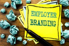 Handwritten text showing Employer Branding. Business concept for Brand Building Written on sticky note paper, wooden background wi. Handwritten text showing stock photo