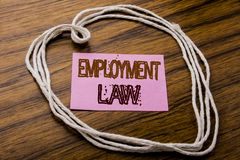 Handwritten text showing Employment Law. Business concept for Employee Legal Justice written on sticky note paper on the dark wood. Handwritten text showing Royalty Free Stock Image