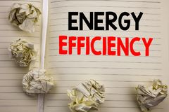 Handwritten text showing Energy Efficiency. Business concept writing for Electricity Ecology Written on notepad note paper, white. Handwritten text showing royalty free stock photo