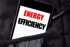 Handwritten text showing Energy Efficiency. Business concept writing for Electricity Ecology Written phone mobile phone, cellphone. Placed in man front jeans stock photo