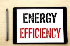 Handwritten text showing Energy Efficiency. Business concept writing for Electricity Ecology Written on tablet computer screen, wh. Ite background office space stock images