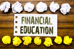 Handwritten text showing Financial Education. Business concept for Finance Knowledge Written on sticky note, wooden with sticky, m royalty free stock photography