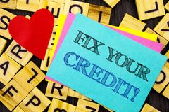 Handwritten text showing Fix Your Credit. Conceptual photo Bad Score Rating Avice Fix Improvement Repair written on colorful stick. Handwritten text showing Fix Royalty Free Stock Photography