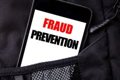 Handwritten text showing Fraud Prevention. Business concept writing for Crime Protection Written phone mobile phone, cellphone pla. Ced in  man front jeans Stock Photo
