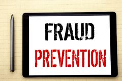 Handwritten text showing Fraud Prevention. Business concept writing for Crime Protection Written on tablet computer screen, white. Background office space view royalty free stock photography