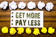 Handwritten text showing Get More Pay Less. Business concept for Budget Slogan Concept Written on sticky note, wooden with sticky,. Handwritten text showing Get Stock Images