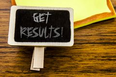 Handwritten text showing Get Results. Business concept for Achieve Result written on announcement board on the wooden wood backgro. Handwritten text showing Get Royalty Free Stock Image