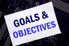 Handwritten text showing Goals Objectives. Business concept for Plan Success Vision Written on sticky note, computer main board ba. Handwritten text showing royalty free stock image