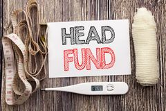 Handwritten text showing Head Fund. Business fitness health concept writing for Investment Funding Money  written sticky note empt. Handwritten text showing Head Stock Photography