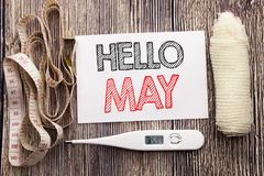 Handwritten text showing Hello May Month. Business fitness health concept writing for Coming Spring Month written sticky note empt. Handwritten text showing Royalty Free Stock Photo